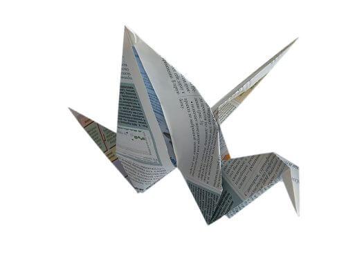 Origami trane ud af gamle bladsider.
