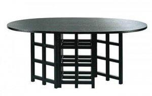Dette spisebord er ret originalt takket være det kontrastfyldte design af bordpladen og benene.
