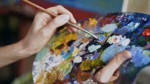 Maler med pensel og palette.