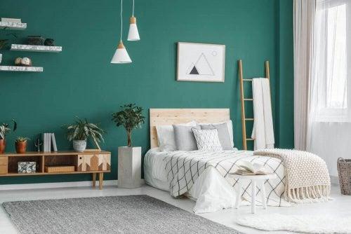 soveværelse med grøn væg