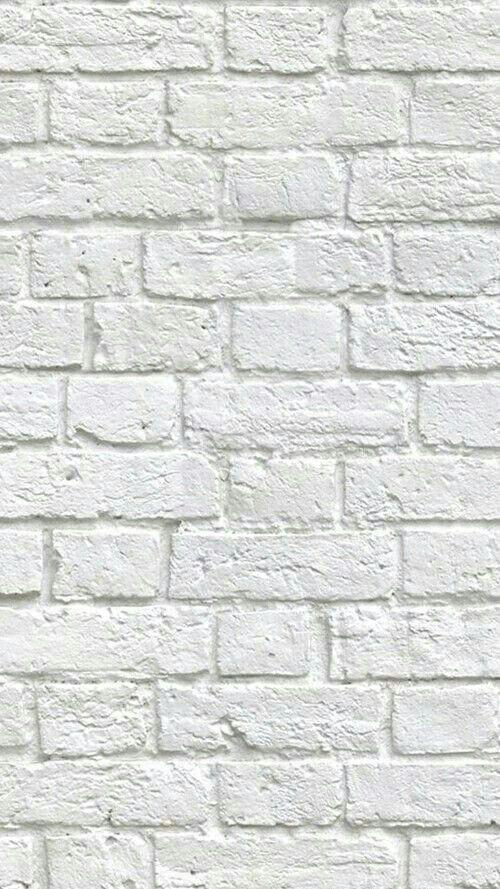 Pared de piedra lacada en blanco