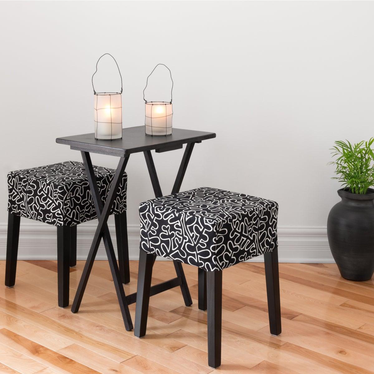 Mesa en negro plegable con taburetes tapizados