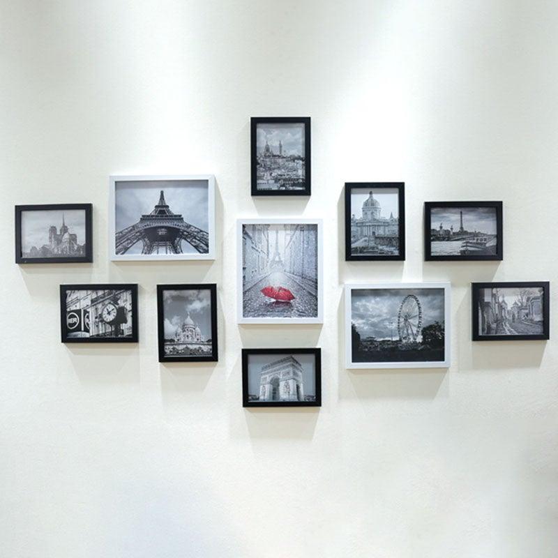 Fotos en marcos colgados de la pared de manera homogénea.