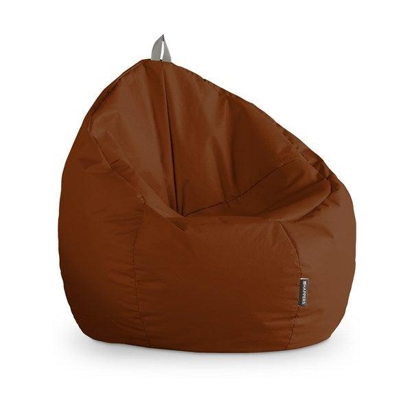 Puff de cuero marrón con forma redonda.