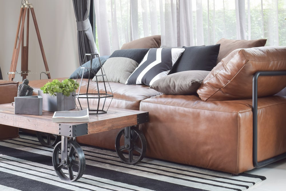 An industrial-style brown sofa.