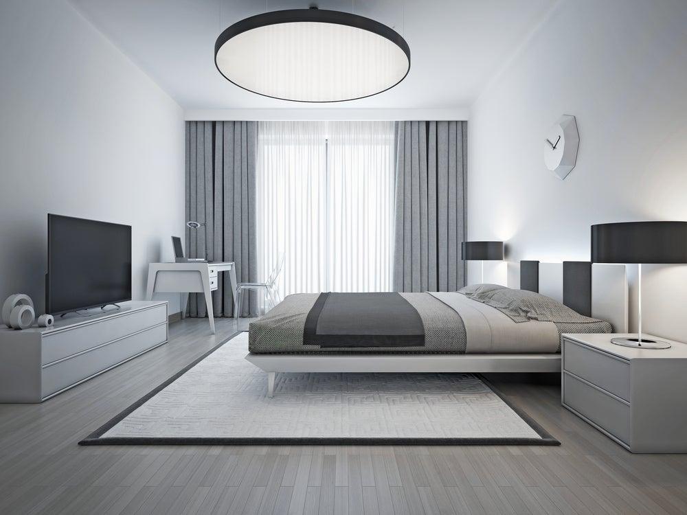 Dormitorio blanco, gris y negro.