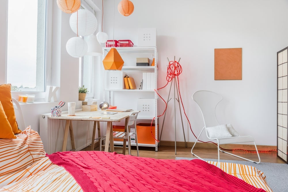 Orange and white decorated children's bedroom.