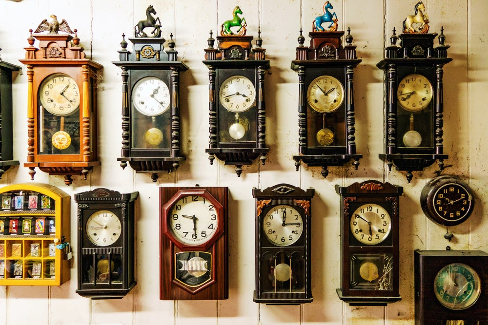 A wall entirely decorated with clocks.