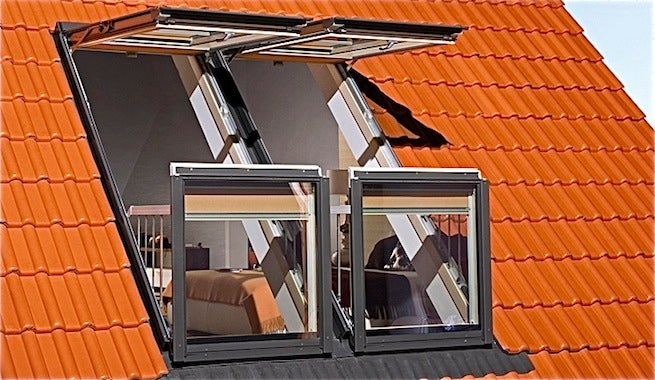 Attic windows that transform into balconies are a great way to enjoy the view.