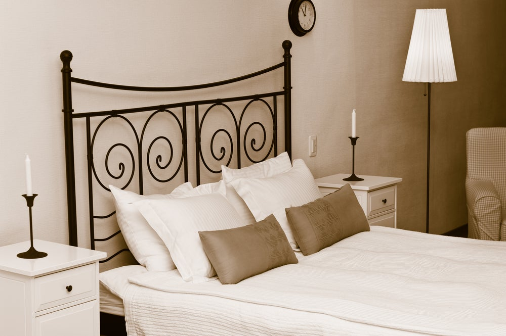 A wrought iron headboard is elegant and sophisticated.