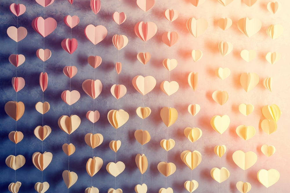 A curtain of silk love hearts.
