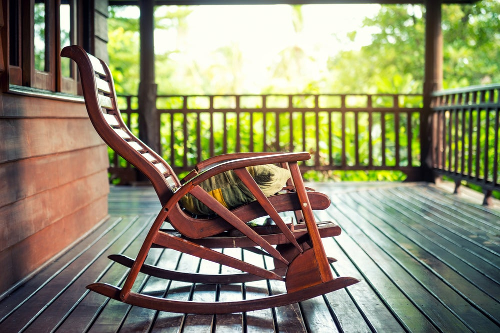A rocking chair on a porch.
