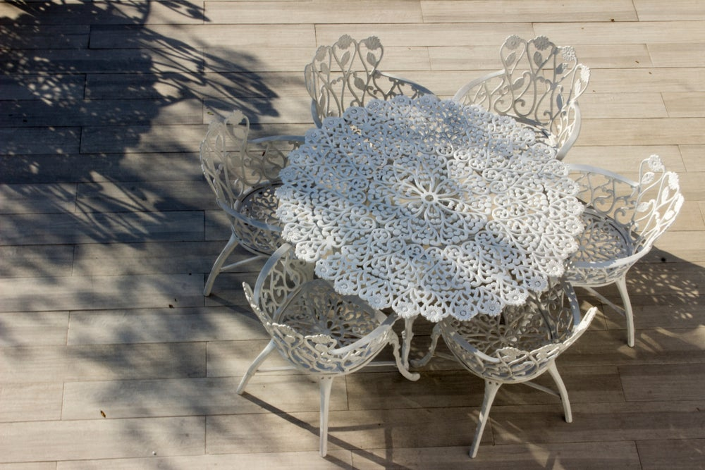 An intricate wrought iron patio table.
