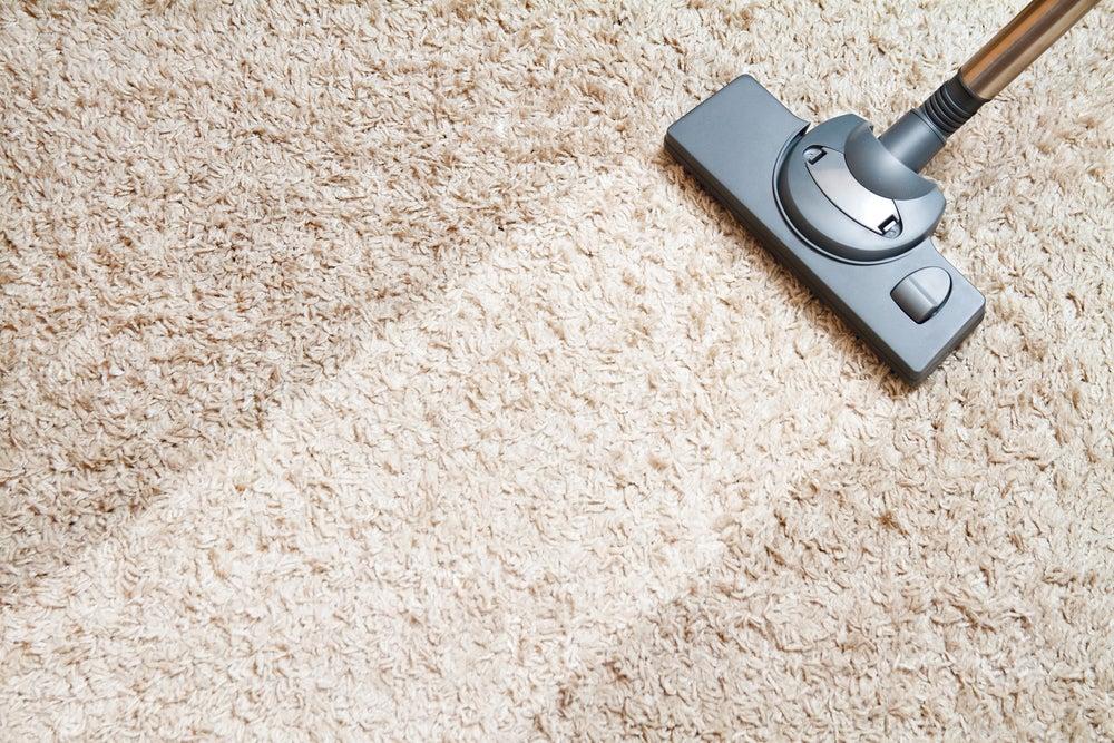 Vacuuming the carpets.