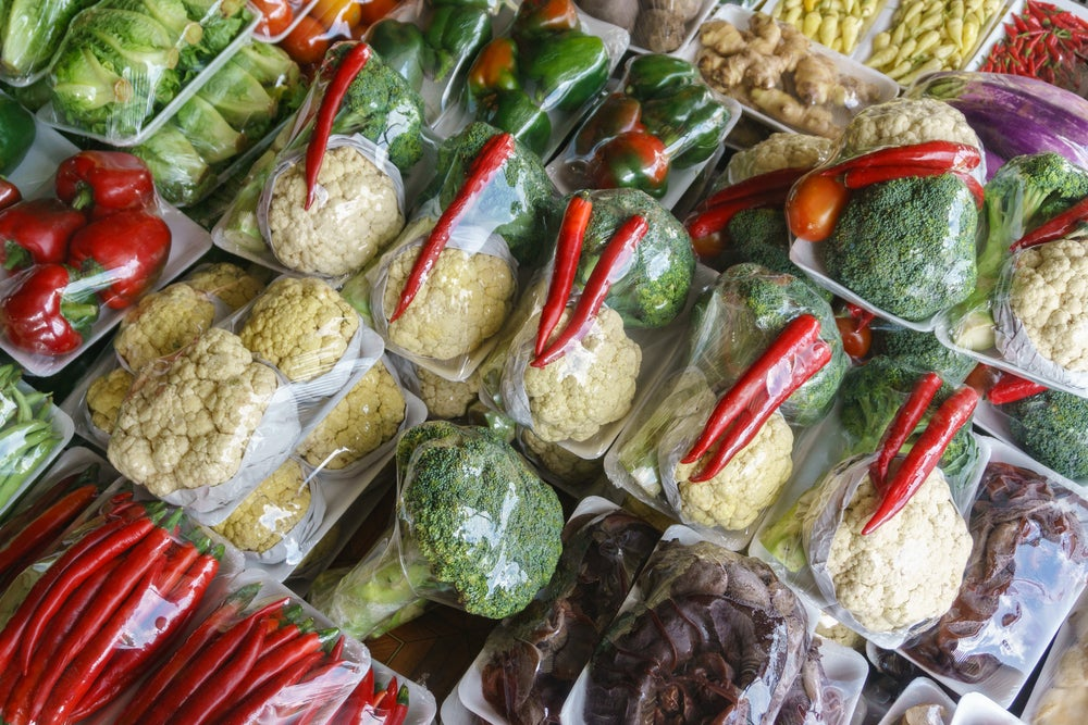 Vegetables wrapped in plastic.