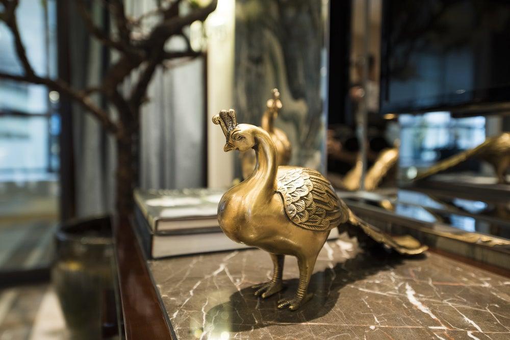 Escultura del pavo real.