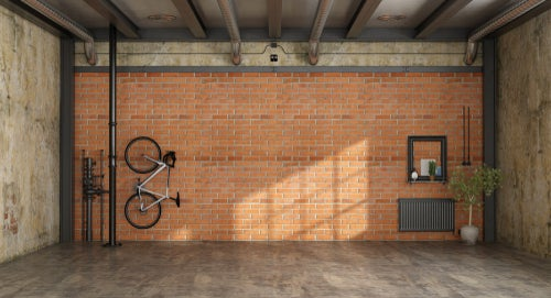 Hang your bike from a vertical bicycle rack so that it takes up less space.