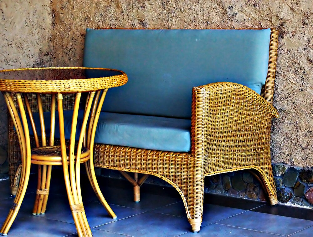 Outdoor wicker table and chair.