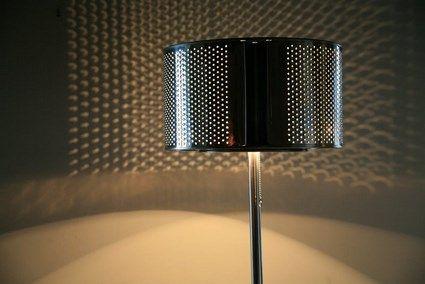 Tambor de una lavadora a modo de lámpara.