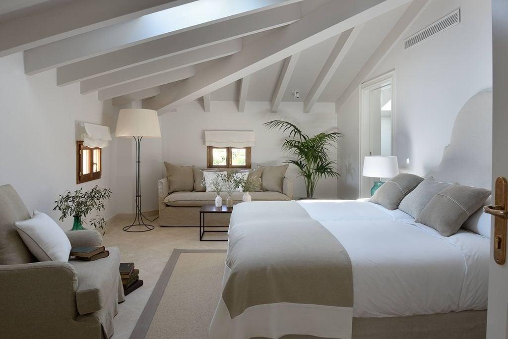 Dormitorio de estilo hotel boutique.