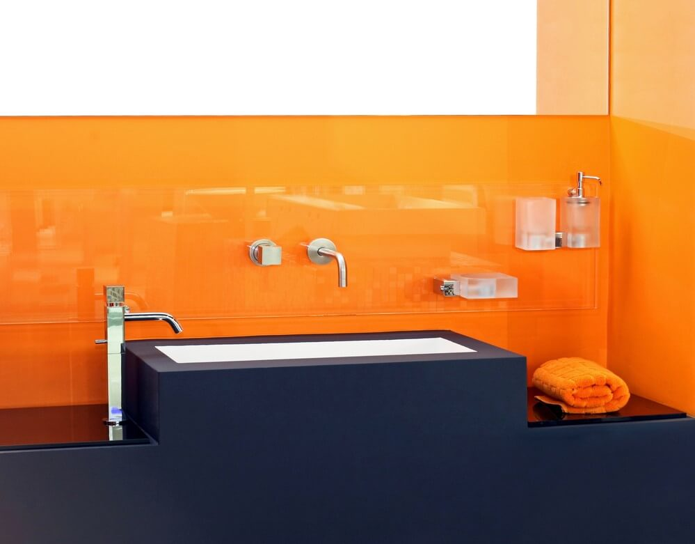 Orange and black bathroom decor.