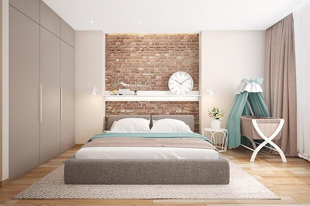 Dormitorio con ladrillo visto.