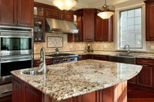 The island is a good space to use terrazzo in the kitchen.