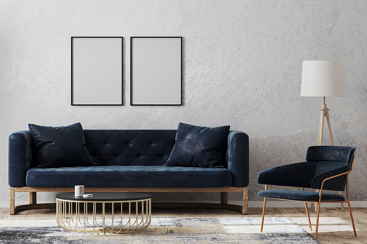 Decorate the rectangular living room with a sofa and thin-legged armchairs.