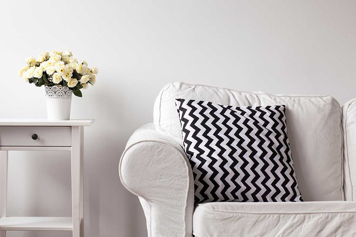 With some cushions you can renew your white sofa.