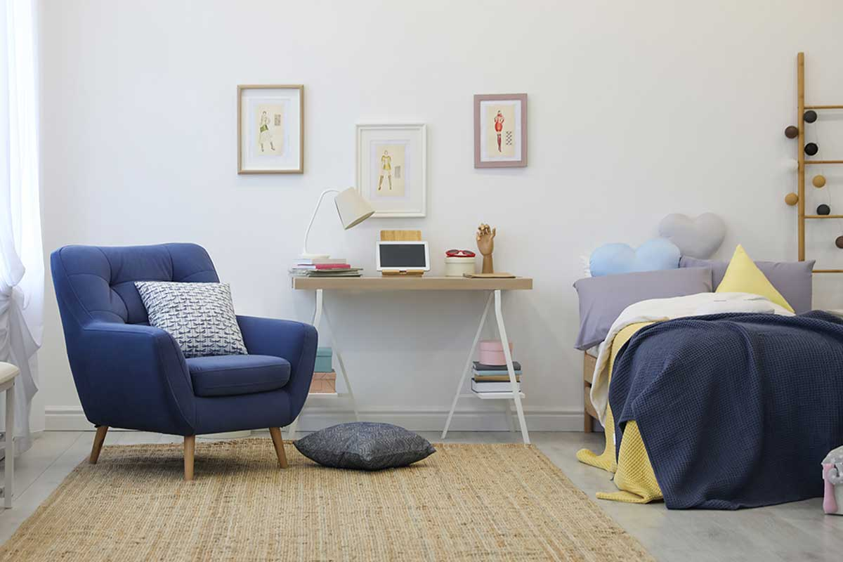Bedroom in blue and yellow tones.