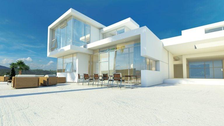 casa con vetrate e giardino con pavimento in cemento bianco