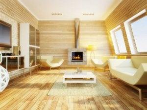 soggiorno con parquet camino e divani bianchi