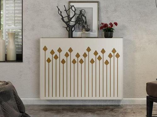 termosifone bianco con motivi decorativi geometrici color oro