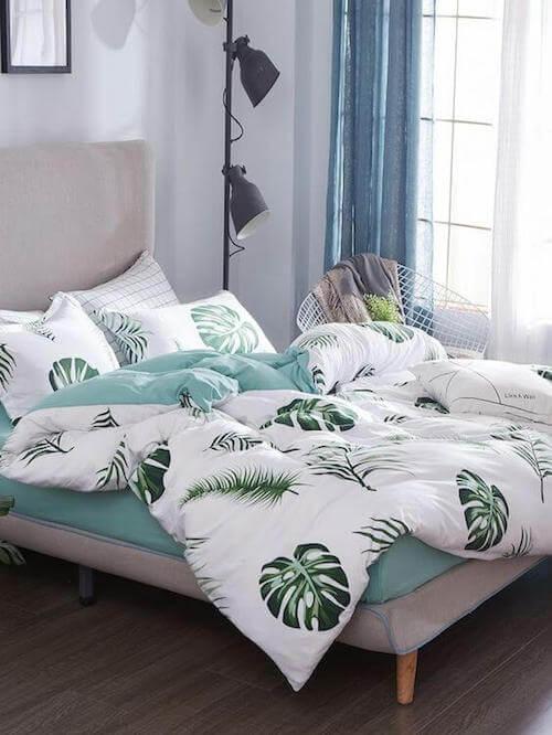 copriletto e cuscini con motivi naturali foglie delle piante