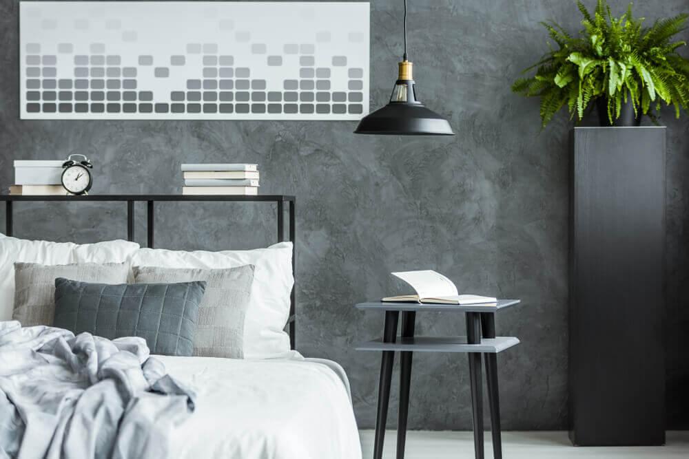 グレイの壁をインダストリアルスタイルの寝室に取り入れたデザイン