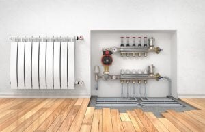 바닥 밑에 설치된 방사 난방 기계