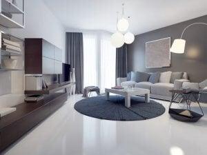 3 woonkamers in grijstinten met een rond kleed