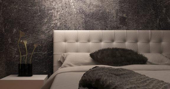 Slaapkamer met een zwarte muur