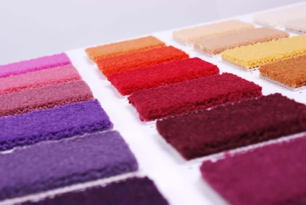 Tapijt samples in allerlei kleuren