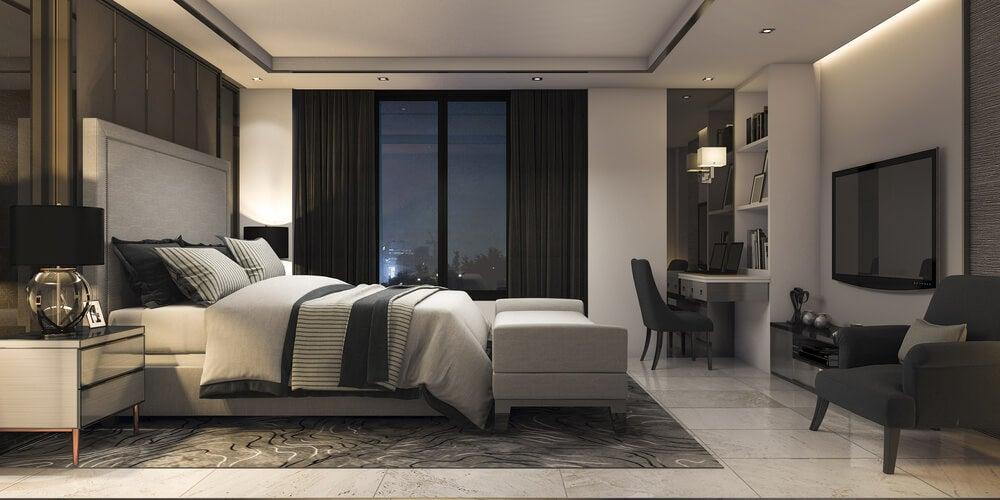 Dê mais calor ao ambiente, incorporando sofás ao pé da cama