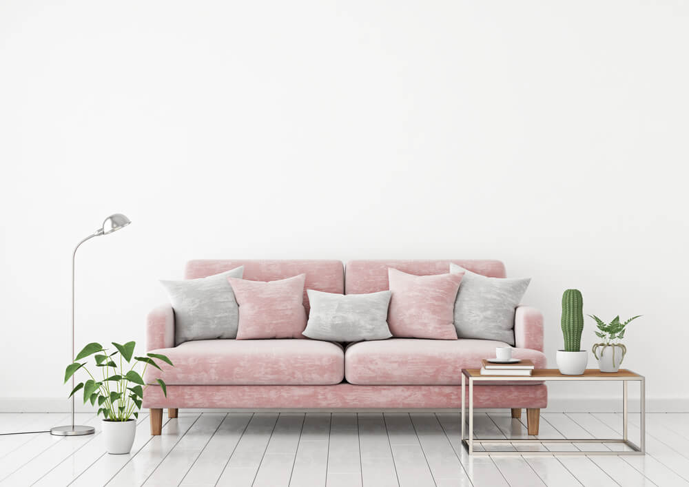 Sofás cor-de-rosa para decorar o seu apartamento