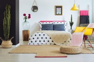Layering patterns and pillows is one of our favorite bedding trends this year.