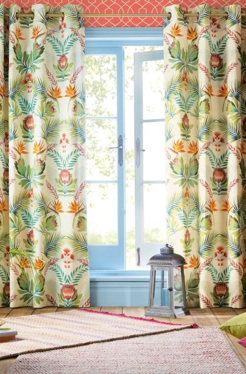 Stamped floral curtains provide a traditional feel