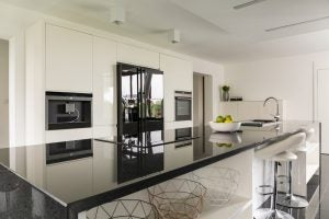 A simple and stylish black kitchen counter will add a touch of sophistication.