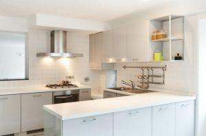 A white, bright kitchen.