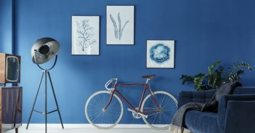 An interior wall with a blue matte finish can add color to the room