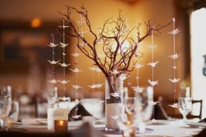 This is a really beautiful and natural centerpiece made of dried branches and little paper birds.