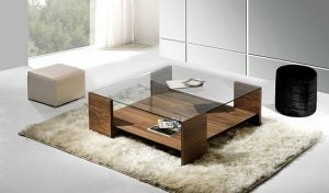 Glass-top coffee tables are more subtle, and won't attract attention away from the rest of your living room.