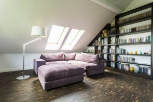 You can buy furniture especially adapted to sloped attic ceilings - like these shelves.