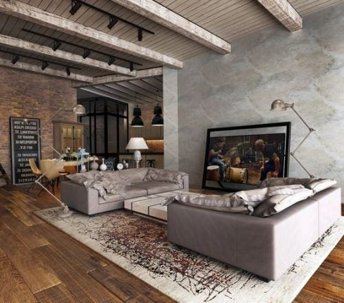 A living room with a rug under the sofas
